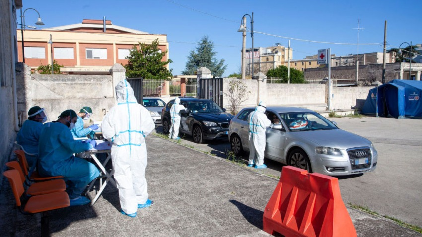 A team of nurses who swab inside the cars of people who have returned from vacation on August 20, 2020 in Bari, Italy.