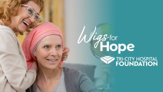 A banner for Wigs for Hope.
