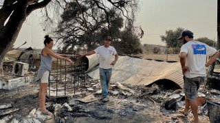 Blake Campos and Alexandra Hultman are left with nearly nothing after the Valley Fire ripped through their Jamul home.