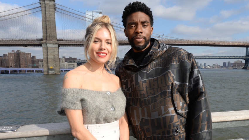 "In this Nov. 19, 2019, file photo, Sienna Miller(L) and Chadwick Boseman poses during a photo call for ""21 Bridges"" at The Fulton in New York City."