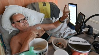 Alain Cocq, suffering from a rare blood disease, rests on his medical bed on August 12, 2020 in his flat in Dijon, northeastern France