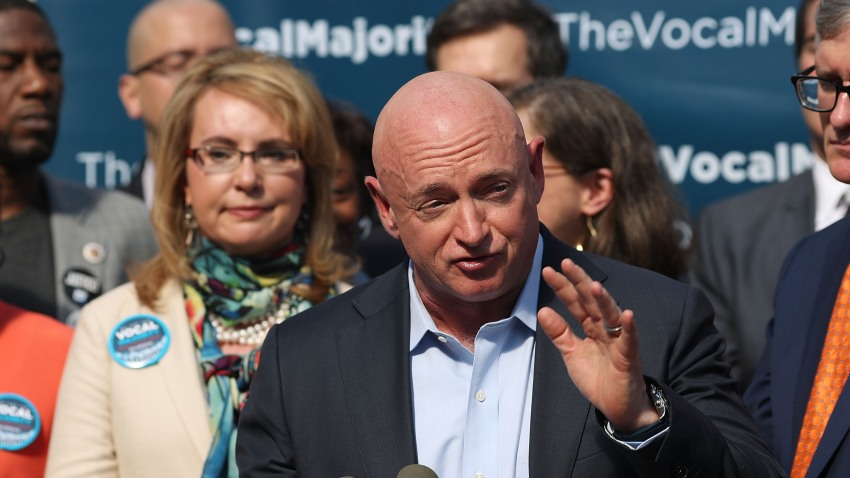 Gun violence victim and former U.S. Congresswoman Gabby Giffords watches her husband, NASA astronaut Mark Kelly, speak as they visits City Hall on her 2016 Vocal Majority Tour on October 17, 2016 in New York City. Giffords and Kelly are on a six-week, nationwide bus tour to battleground states asking people to vote for candidates who support gun violence prevention legislation in this coming November election. The Vocal Majority Tour is a project of their national organization, Americans for Responsible Solutions PAC. Giffords, who has made a dramatic recovery, survived an assassination attempt in 2011 near Tucson, Arizona.