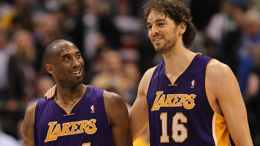 In this March 12, 2011, file photo, Kobe Bryant #24 and Pau Gasol #16 of the Los Angeles Lakers react after a 96-91 win against the Dallas Mavericks at American Airlines Center in Dallas, Texas.