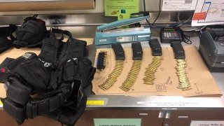 Escondido police provided this photo of tactical gear, ballistics and weapons that were allegedly stolen from an officer in San Diego.