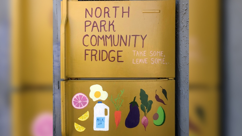 a yellow community fridge in North Park