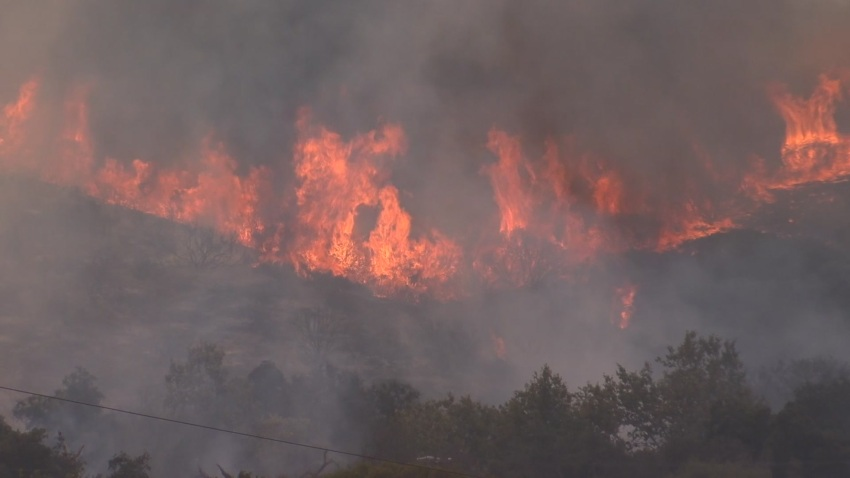 Unruly flames are seen coming from the ferocious Valley Fire.