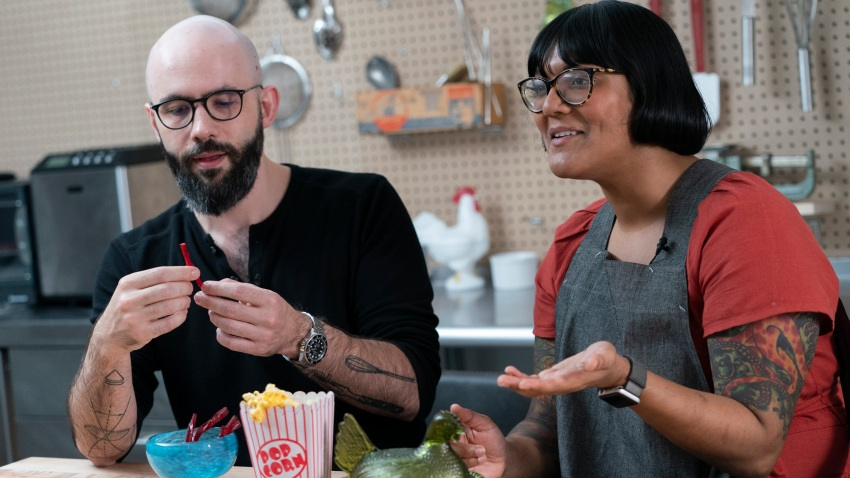 Andrew Rea, founder of the Binging with Babish network, left, tastes a beet parsnip licorice created by chef Sohla El-Waylly