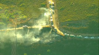 Firefighters taking control of a small brush fire burning in Descanso.