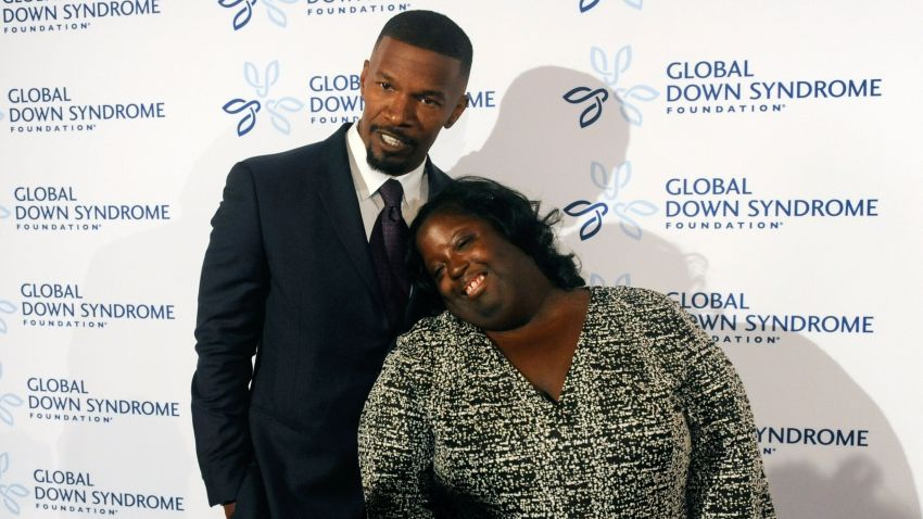 """In this Nov. 12, 2016, file photo, actor Jamie Foxx poses for pictures with his sister DeOndra Dixon before the start of the 2016 Global Down Syndrome Foundation """"Be Beautiful, Be Yourself"""" fashion show at the Colorado Convention Center in Denver, Colorado."""