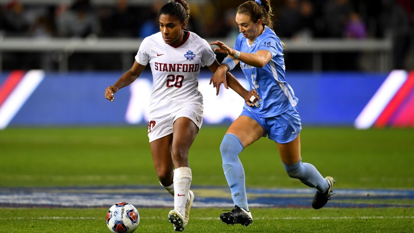 Catarina Macario #20 of the Stanford Cardinal and Morgan Goff #14 of the North Carolina Tar Heels battle for the ball during the Division I Women's Soccer Championship held at Avaya Stadium on December 8, 2019 in San Jose, California.