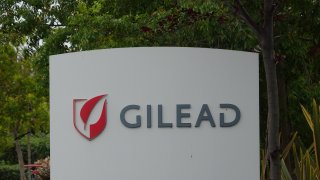 Sign with logo for pharmaceutical company Gilead in the Silicon Valley, Foster City, California, April 11, 2020.