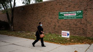 DETROIT, MI - OCTOBER 15: People make their way to cast their absentee ballot and drop it off at one of the Satellite Voting Center inside Adams-Butzel Recreational Complex during early U.S. Presidential Election voting in Detroit, Michigan on Thursday, October 15, 2020.