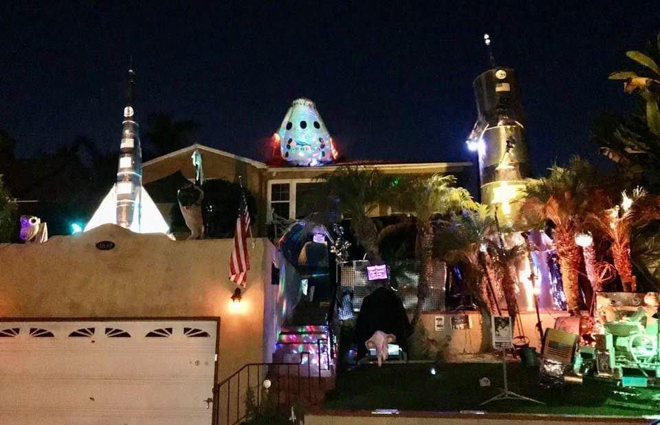 """What the """"House of Rockets"""" looks like at night -- complete with its brilliant lights and impressive, out-of-this-world display."""