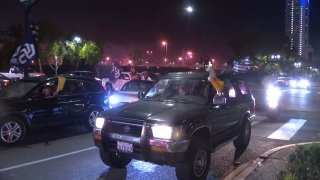 Padres fans celebrate after attending a drive-in viewing experience at Tailgate Lot.