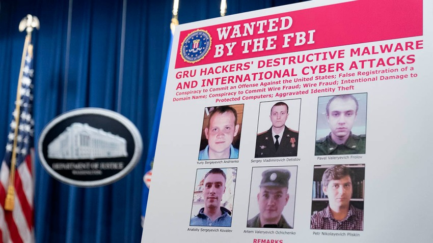 A poster shows six Russian military intelligence officers wanted by the U.S. government. The U.S. Department of Justice announced charges against the officers for their alleged involvement in a vast hacking campaign that targeted the Olympics, foreign elections and U.S. businesses, on Oct. 19, 2020, in Washington.
