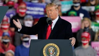 President Donald Trump speaks at a campaign rally at Des Moines International Airport, Wednesday, Oct. 14, 2020, in Des Moines, Iowa.