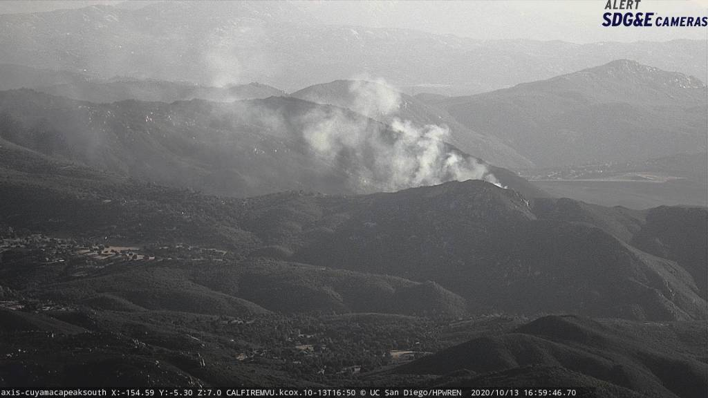 The view of a small brush fire burning near Descanso, shot form an SDG&E camera positioned atop Mount Cuyamaca, facing south.