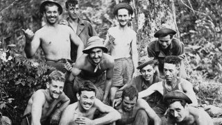 """FILE - In this April 3, 1944, file photo, a jungle fighting outfit known as """"Merrill's Marauders,"""" pose for a photo in North Burma, now known as Myanmar. The World War II unit that spent months marching and fighting behind enemy lines in Burma has been approved to receive Congress' highest honor."""