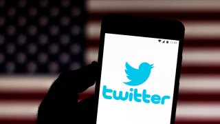 In this photo illustration a Twitter logo is seen on a smartphone.