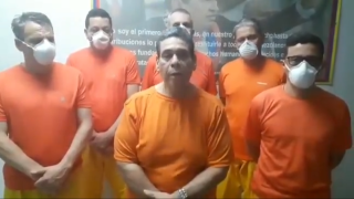 This screenshot of a video posted on Twitter on June 17, 2020, by Venezuela's Foreign Minister Jorge Arreaza shows CITGO oil executives Jose Angel Pereira, Gustavo Cardenas, Jorge Toledo, Jose Luis Zambrano, Tomeu Vadell and Alirio Jose Zambrano in Caracas, Venezuela, during a legal proceeding.