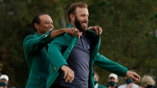 Tiger Woods helps Masters' champion Dustin Johnson with his green jacket