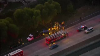 SkyRanger 7 is over the freeway involving an SDPD officer