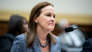"""In this March 13, 2019, file photo, Former Defense Undersecretary for Policy Michele Flournoy prepares to testify during the House Foreign Affairs Committee hearing on """"NATO at 70: An Indispensable Alliance."""""""