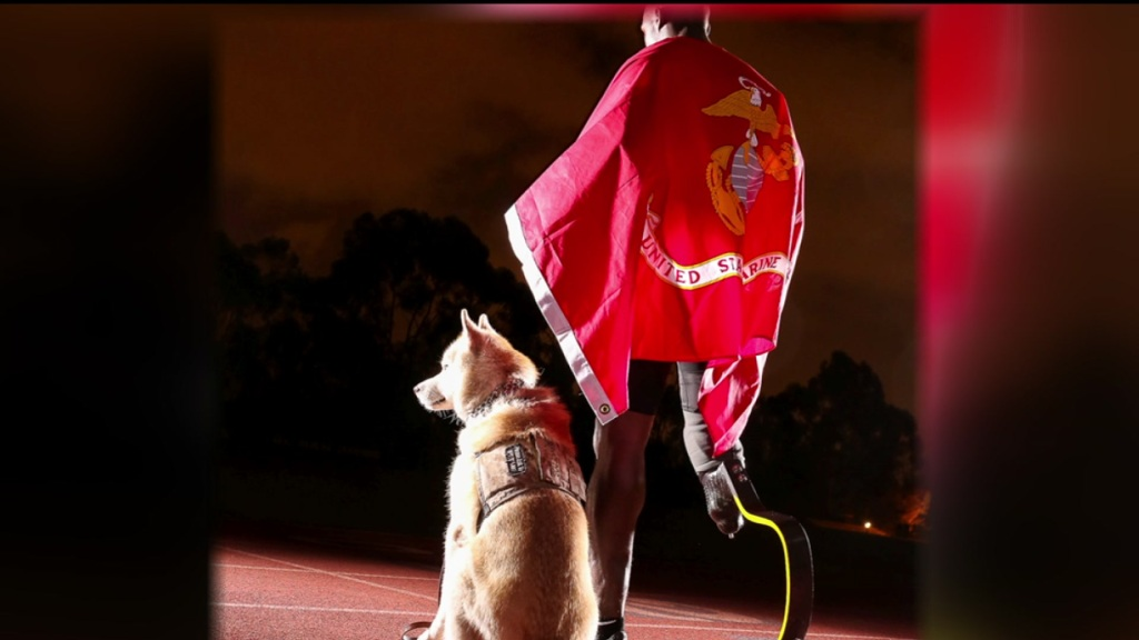 Veteran Kionte Storey and his service dog, Koja.