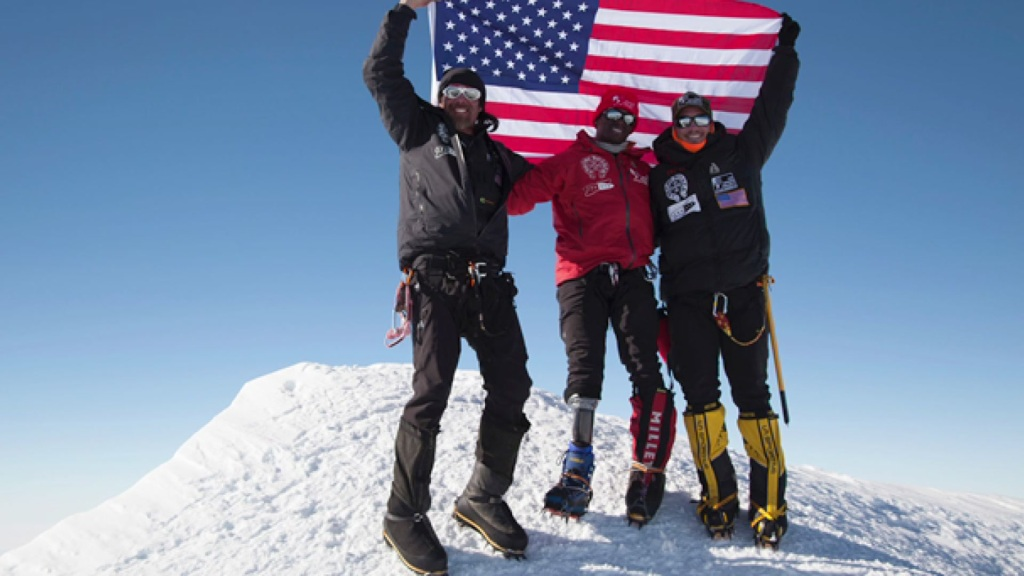 Kionte Storey and his friends celebrate the completion of their trek up Mount Vinson in Antarctica.