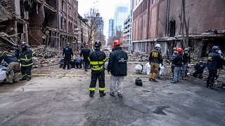 In this Dec. 28, 2020, photo provided by the FBI and Bureau of Alcohol, Tobacco, Firearms and Explosives, FBI and ATF Evidence Response Teams process the scene of the Christmas Day blast in Nashville, Tennessee.