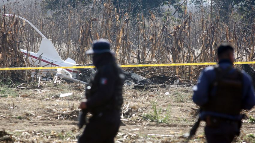 Members of the Federal Police search the scene on December 25, 2018 of a helicopter crash in which the governor of the Mexican state of Puebla, Martha Erika Alonso, and her husband, senator and former governor of the same region, Rafael Moreno, died on December 24 when the chopper plummeted to the ground in San Pedro Tlaltenango after taking off from the nearby city of Puebla.