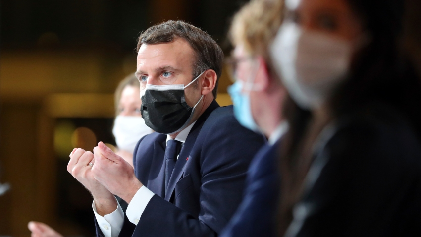 In this Dec. 14, 2020, file photo, France's President Emmanuel Macron delivers a speech during a Citizens' Convention on Climate, in Paris, France.