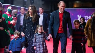 In this Dec. 11, 2020, file photo, Prince William, Duke of Cambridge, and Catherine, Duchess of Cambridge, with their children, Prince Louis, Princess Charlotte and Prince George, attend a special pantomime performance at London's Palladium Theatre, hosted by The National Lottery, to thank key workers and their families for their efforts throughout the pandemic in London, England.