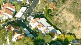 police surround a home in scripps ranch after a shooting