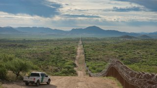 Border Patrol Agent watches along the Border near Sasabe Arizona. The border wall ends in this area. 4/29/2019