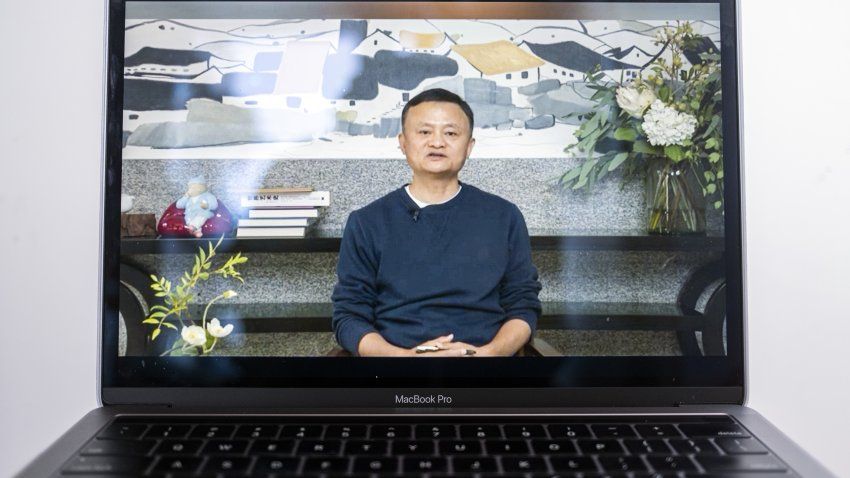 A video recording of a livestream of Jack Ma, co-founder of Alibaba Group Holding Ltd., addressing teachers at an annual event he hosts to recognize rural educators, on a laptop computer arranged in Hong Kong, China, on Wednesday, Jan. 20, 2021. Mahas resurfaced after months out of public view that fueled intense speculation about the plight of the billionaire grappling with escalating scrutiny over his internet empire.