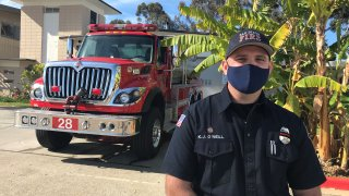 San Diego Fire Fighter Kyle O'Neill stands outside of Fire Station 28