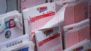 Mega Millions lottery tickets sit inside a convenience store in Lower Manhattan, October 23, 2018 in New York City.