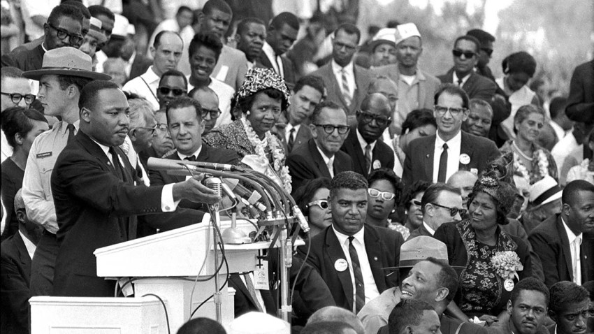 """FILE - In this Aug. 28, 1963 file photo, the Rev. Dr. Martin Luther King Jr., head of the Southern Christian Leadership Conference, speaks to thousands during his """"I Have a Dream"""" speech in front of the Lincoln Memorial for the March on Washington for Jobs and Freedom, in Washington."""