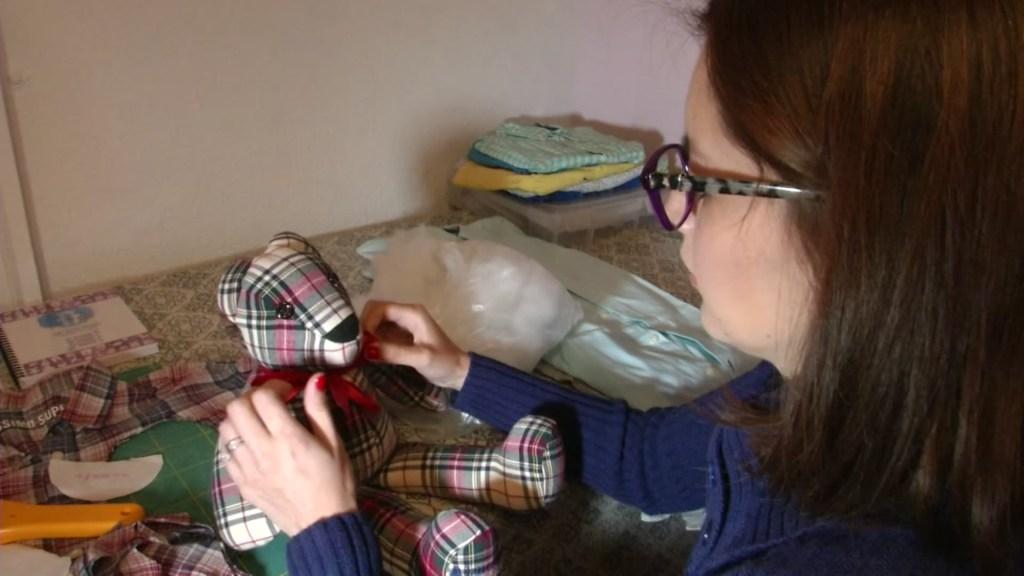 Designer Karla Cantero works on a Memory Bear.
