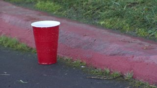 A red solo cup is seen outside a Miramar warehouse that hosted a New Year's Eve party against public health orders.