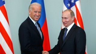 FILE - In this March 10, 2011, file photo, then-Vice President Joe Biden, left, shakes hands with Russian Prime Minister Vladimir Putin in Moscow, Russia. Russia and the United States exchanged documents Tuesday Jan. 26, 2021, to extend the New START nuclear treaty, their last remaining arms control pact, the Kremlin said. The Kremlin readout of a phone call between U.S. President Joe Biden and Russian President Vladimir Putin said they voiced satisfaction with the move.