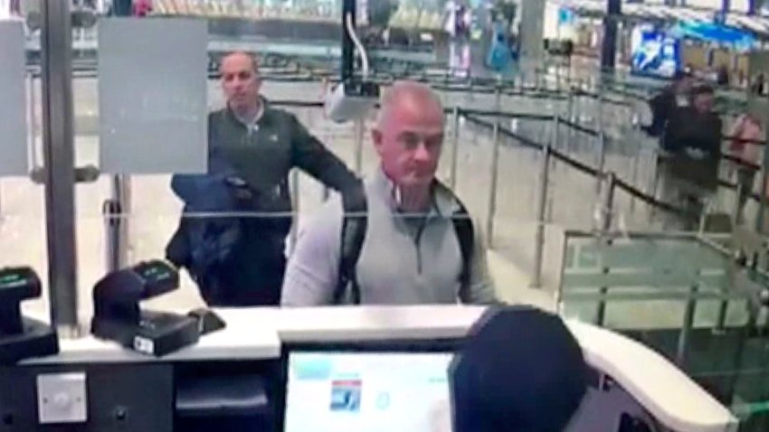This Dec. 30, 2019, file image from security camera video shows Michael L. Taylor, center, and George-Antoine Zayek at passport control at Istanbul Airport in Turkey. An American father and son have been extradited to Japan and charged for smuggling former Nissan Motor Co. Chairman Carlos Ghosn out of the country while he was awaiting trial.