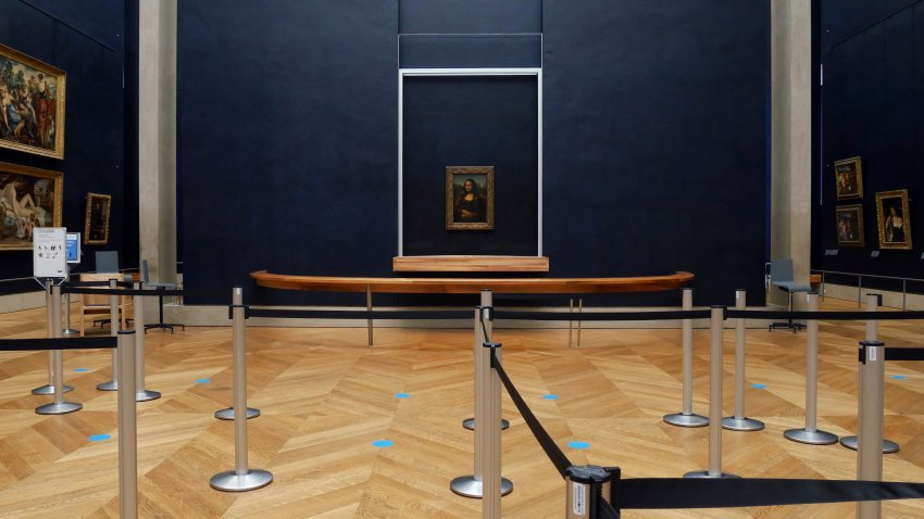 Leonardo da Vinci's Mona Lisa hangs on the wall in a deserted Louvre museum, in Paris.