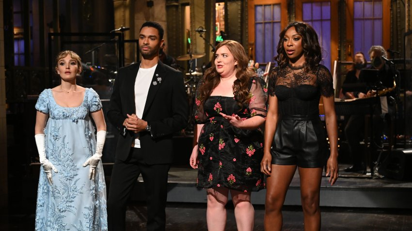 """""""Regé-Jean Page"""" Episode 1798 -- Pictured: (l-r) Chloe Fineman as Daphne, host Regé-Jean Page, Aidy Bryant, and Ego Nwodim during the Monologue on Saturday, February 20, 2021"""