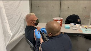 Homeless individual receiving the COVID-19 vaccine at the convention center