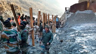 Indo Tibetan Border Police (ITBP) personnel undertake rescue work at one of the hydro power project at Reni village in Chamoli district, in Indian state of Uttrakhund, Monday, Feb.8, 2021. Rescue efforts continued on Monday to save 37 people after part of a glacier broke off, releasing a torrent of water and debris that slammed into two hydroelectric plants on Sunday.