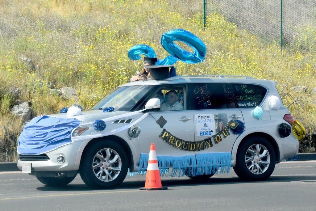 Photograph of a drive-thru graduation celebration by Criselda Yee.