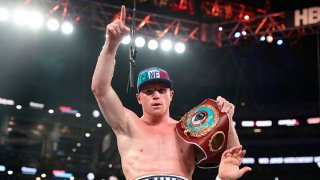 Canelo Alvarez celebrates after knocking out Liam Smith, lower, during the WBO Junior Middleweight World fight at AT&T Stadium on Sept. 17, 2016 in Arlington, Texas.