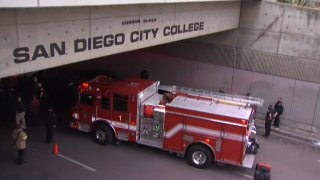 San Diego firefighters and police officers respond to the scene of a crash that left several people injured near San Diego City College in downtown.